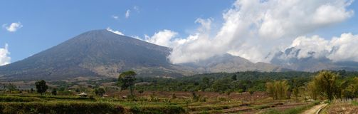 Panorama of Mount Rinjani or Gunung Rinjani, active volcano in Indonesia on the island of Lombok.  Stock Photos