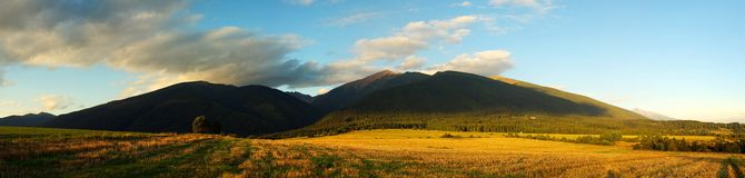 Panorama of mountain fields and meadows Stock Photo