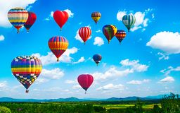 Panorama of mountain with hot air balloons on morning at Thailand. stock photos