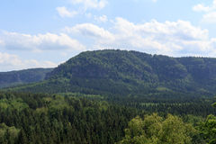 Panorama with mountain Kleiner Winterberg and forest seen from Kuhstall in Saxon Switzerland Stock Photos