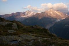 Panorama of mountain lake in Alps Royalty Free Stock Photo