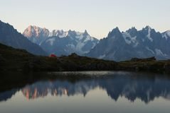 Panorama of mountain lake in Alps Royalty Free Stock Photography