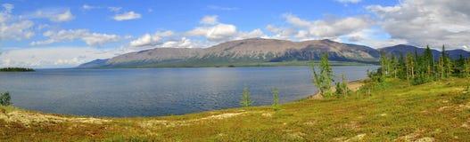 Panorama mountain lakes on the Putorana plateau. Royalty Free Stock Photo