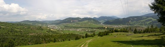 Panorama of mountain landscape. With green forest and grass royalty free stock photos