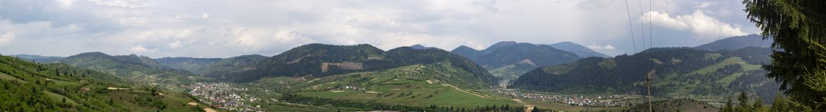 Panorama of mountain landscape. With green forest and grass stock photo