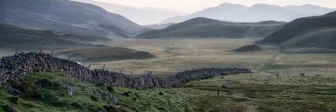 Panorama mountain landscape through misty sunrise Stock Photos