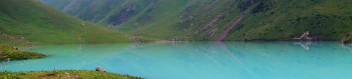 Panorama of a mountain milky blue lake. Tor, water, keltor royalty free stock photography