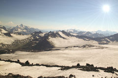 Panorama of mountain peaks in the sun, the majesty and beauty of Royalty Free Stock Images