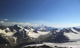 Panorama of mountain peaks in the sun, the majesty and beauty of Royalty Free Stock Image