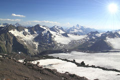 Panorama of mountain peaks in the sun, the majesty and beauty of Stock Images