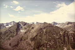 Panorama of a mountain range with gray clouds. Royalty Free Stock Photo