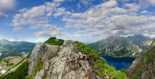 Panorama of mountain range with lakes in the valley Stock Photos