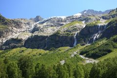 Panorama of a mountain range with waterfalls Royalty Free Stock Images