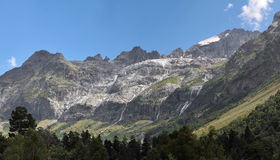 Panorama of mountain range with waterfalls Royalty Free Stock Photo