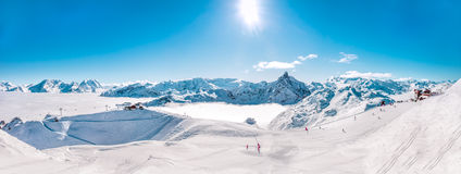 Panorama of Mountain Range winter Landscape in French Alps. Panorama of Mountain Range winter Landscape with Blue Sky and skiing slopes at Meribel Skiing Resort Royalty Free Stock Photography