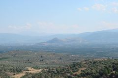 The ancient town of Mycenae on the peninsula Peloponnese. Greece. 06. 19. 2014. Landscape of the ruins of ancient Greek architectu royalty free stock image