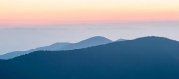 Panorama  mountain ridges silhouettes Stock Photos