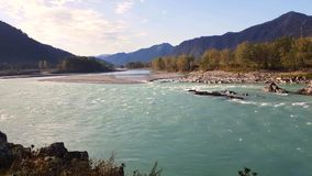 Panorama of the mountain river, turquoise water, summer and autumn stock video