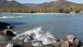 Panorama of the mountain river, turquoise water, summer and autumn stock video footage