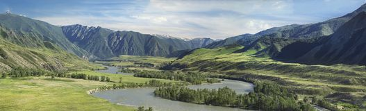river in a wide valley stock photography