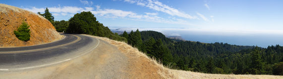 Panorama of mountain road with fog and the ocean. A twisty panoramic road alongside Mt. Tamalpais in the San Francisco bay area. Below the road is the San Royalty Free Stock Photos