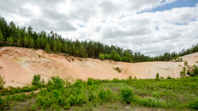 Panorama mountain sand quarry with a man Stock Photo