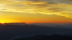 Panorama of mountain silhouettes at sunset Stock Photo