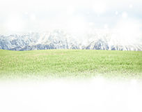 Panorama of Mountain Snow  Landscape with green grass . Stock Photo