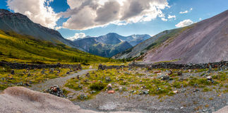 Panorama of a mountain stream, glacier and rocks Royalty Free Stock Photo