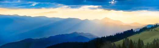 Panorama of mountain at sunset Stock Photos