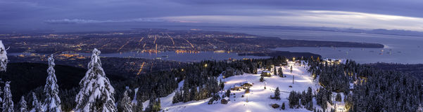 Panorama from mountain top overlooking city lights Royalty Free Stock Image
