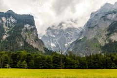 Panorama of the mountain valley near Konigsee lake. Germany stock photography