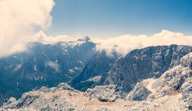 Panorama of a mountain valley partly covered with clouds Stock Images