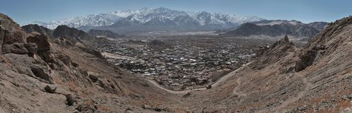 Panorama of a mountain village, in the foreground a semicircle slope, further downstairs are small village houses, Lekh, Ladakh, N Stock Image