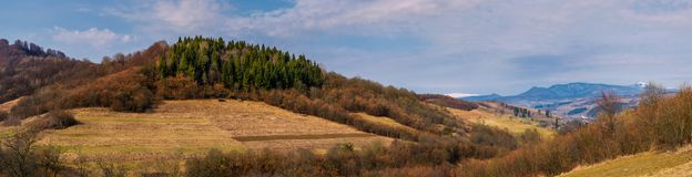 Panorama of mountainous area of Carpathians. Lovely springtime landscape located near the Volovets town, Ukraine Royalty Free Stock Photo