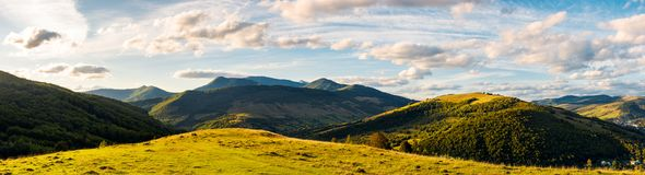 Panorama of mountainous countryside. Beautiful evening weather with cloudy sky over the ridge stock photos