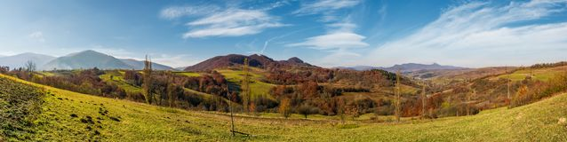 Panorama of mountainous rural area in autumn Stock Photography