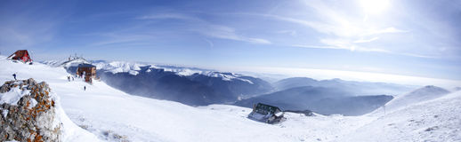 Panorama of mountains. On winter stock photography