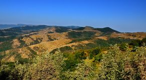 Panorama of mountains with blue sky in Russia Krasnodar region. Panorama of mountains with blue sky in Russia, Krasnodar region stock photography
