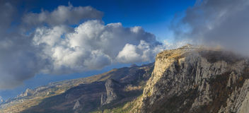 Panorama of mountains in the clouds Royalty Free Stock Images