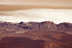 Panorama mountains in dusk clouds in red planet Mars Stock Photo