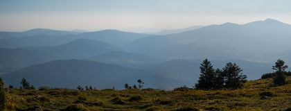 Panorama of mountains on a foggy morning stock photo