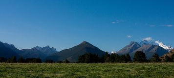 A panorama of mountains including mt. Alfred in Glenorchy in New Zealand stock photography