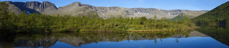 Panorama with the mountains of the Khibiny, sky reflected in the. Lake Small Vudyavr. Kola Peninsula, Russia Stock Photography