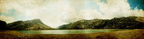 Panorama in the mountains with lake and clouds Royalty Free Stock Images