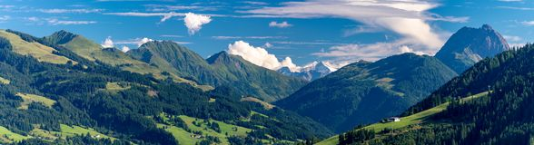 Panorama of mountains with mountain pastures. In front of Mt. Schneekopf royalty free stock images