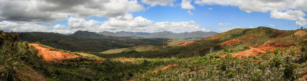 Panorama on the mountains and red soil of the South of Grande Terre, New Caledonia Royalty Free Stock Image