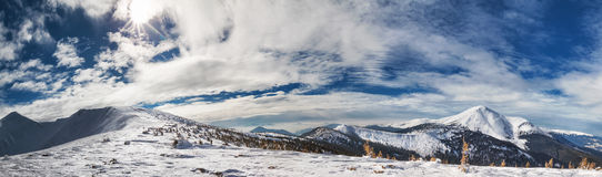 Panorama of mountains with snow-capped peaks Royalty Free Stock Photo