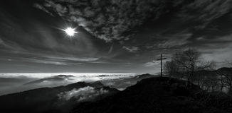 Panorama mountains with summit cross Stock Images