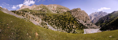 Panorama of the mountains to the river, peaks and greens. View of the mountain valley in Kyrgyzstan Dugoba. mountaineering camp Dugoba Royalty Free Stock Image